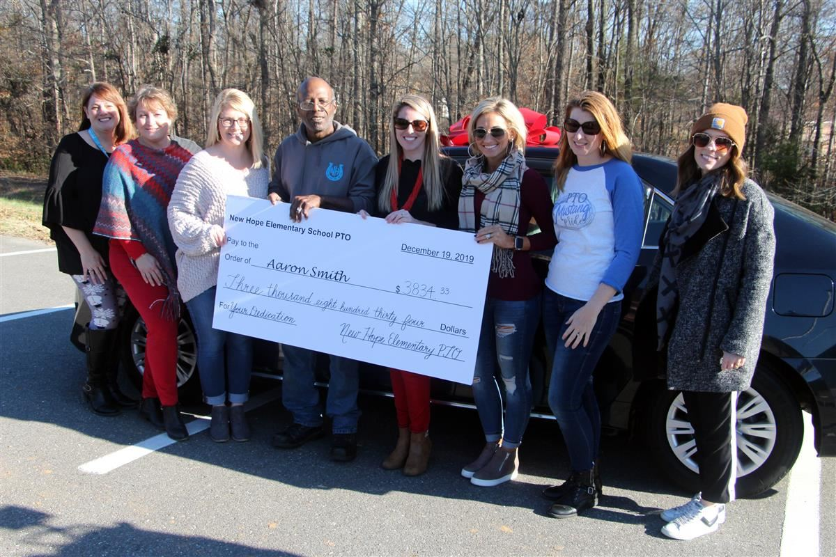 New Hope Elementary School Aaron Smith was given a new vehicle and presented with a check by the school PTO.