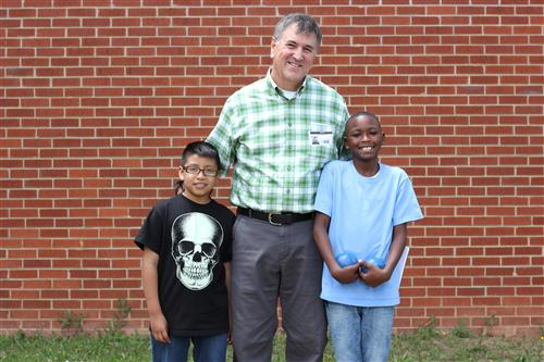 Scott Crabtree is pictured with two students at H.H. Beam Elementary