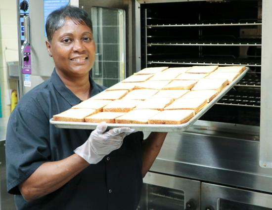 Marie Beard holds up a tray of grill cheese.