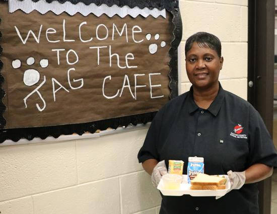 Marie Beard displays today's lunch for Forestview High School students.
