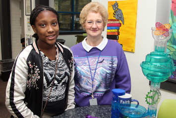 York Chester Middle School student Damayiah plays a game with her mentor.