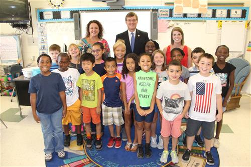 Superintendent W. Jeffrey Booker poses with children at Gardner Park Elementary