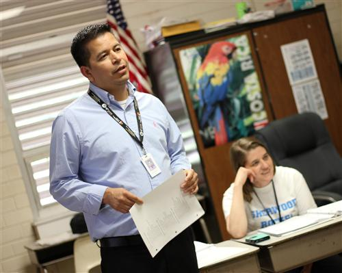 ESL teacher Edgar Coronado teaches Spanish to teachers at Sherwood Elementary